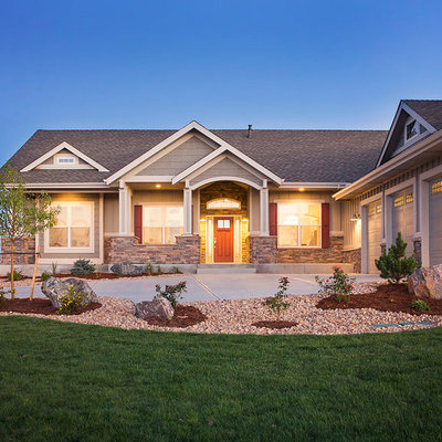 Example of a mid-sized arts and crafts gray one-story mixed siding gable roof design in Denver