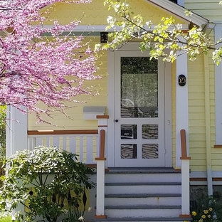 Mid-sized elegant yellow two-story wood exterior home photo in Other