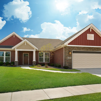 Example of a small arts and crafts red one-story mixed siding exterior home design in Other