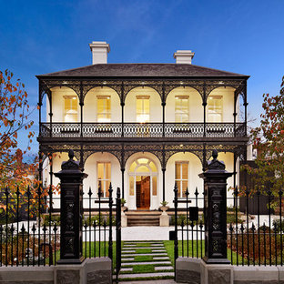 Victorian two-story exterior home idea in Melbourne with a hip roof