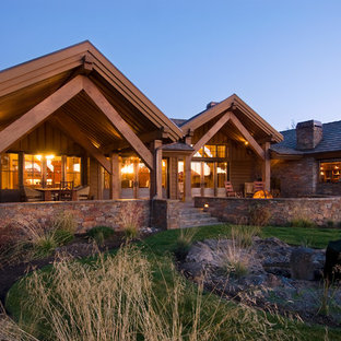 Example of a mountain style brown one-story exterior home design in Portland