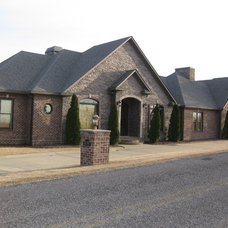 Eclectic Exterior by Benchmark Construction Co., LLC