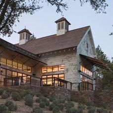 Rustic Exterior by Kahn Design Associates