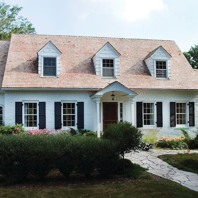 Example of a classic two-story brick gable roof design in Minneapolis