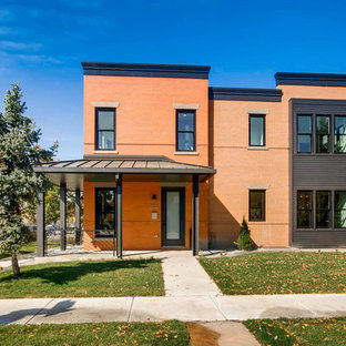 Transitional red two-story brick exterior home photo in Denver