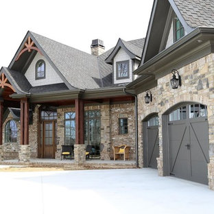 Design ideas for a large arts and crafts two-storey brick brown exterior in Nashville with a gable roof.