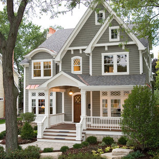 Example of a classic gray two-story wood gable roof design in Chicago