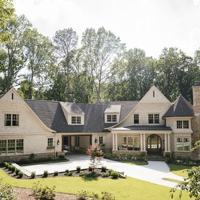 Inspiration for a large craftsman beige two-story wood house exterior remodel in Atlanta with a hip roof and a shingle roof