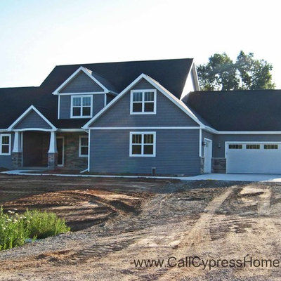 Mid-sized traditional gray two-story vinyl exterior home idea in Other