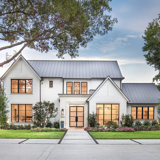 Transitional white two-story brick exterior home photo in Dallas with a metal roof