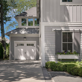 Example of a cottage exterior home design in Chicago