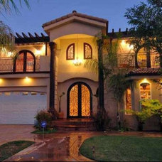 Mediterranean Exterior by Los Angeles Remodeling and Construction