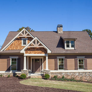 Inspiration for a large timeless beige two-story mixed siding house exterior remodel in Atlanta with a shingle roof and a hip roof