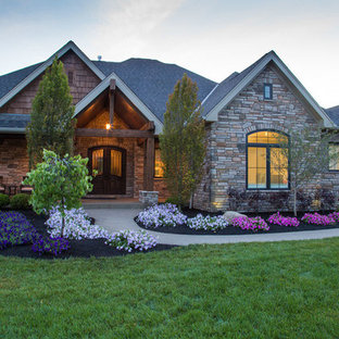 Large mountain style brown one-story brick exterior home photo in Cincinnati