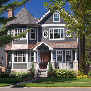 Inspiration for a large timeless gray three-story wood exterior home remodel in Chicago
