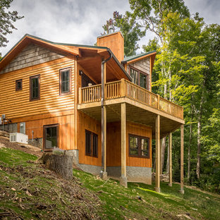 Inspiration for a mid-sized rustic brown two-story mixed siding house exterior remodel in Charlotte