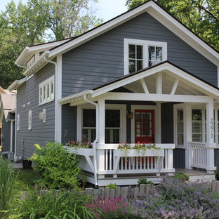 Craftsman yellow two-story exterior home idea in Indianapolis