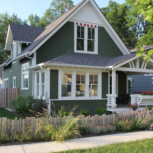 Example of a mid-sized arts and crafts green two-story house exterior design in Indianapolis