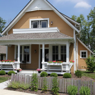 Example of an arts and crafts yellow two-story exterior home design in Indianapolis