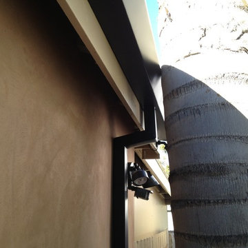Custom cut Downspouts with contemporary Rain Gutters in Costa Mesa