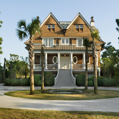 Beach style two-story wood gable roof photo in New York
