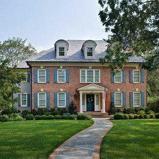 Example of a classic brick exterior home design in Philadelphia