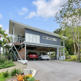 Inspiration for a contemporary two-storey grey house exterior in Cairns with mixed siding and a shed roof.