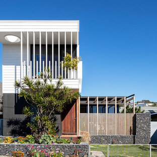 Inspiration for a modern two-storey exterior in Newcastle - Maitland with a flat roof.