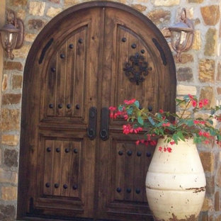 Ex&le of a tuscan beige stone exterior home design in San Diego & Tuscan Entry Doors | Houzz