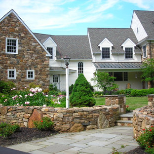 Large elegant three-story stone exterior home photo in Philadelphia