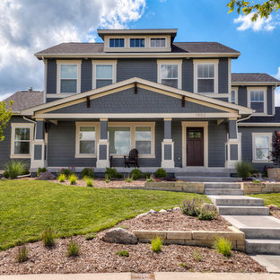 Arts and crafts blue three-story exterior home photo in Other with a shingle roof