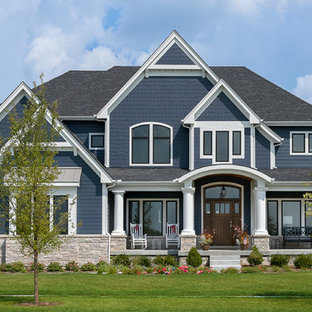Example of a large arts and crafts blue two-story concrete fiberboard house exterior design in Chicago with a mixed material roof