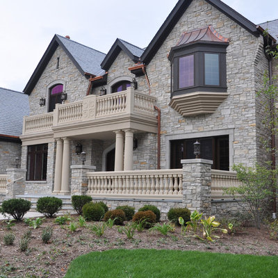 Example of a large classic gray two-story stone exterior home design in Chicago with a shingle roof