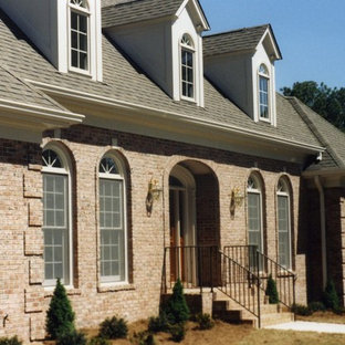 Example of a large classic two-story brick exterior home design in Atlanta