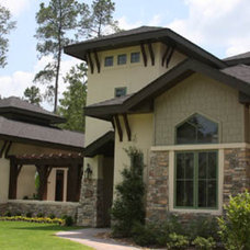 Exterior by Guy M. Land Designer Incorporated