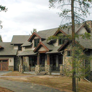 Example of a large arts and crafts exterior home design in Denver