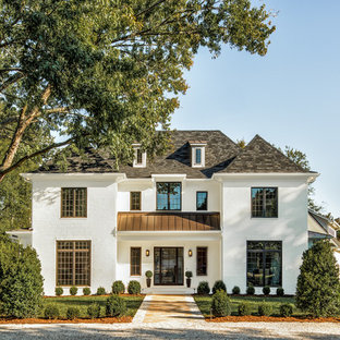 Huge transitional white two-story brick exterior home idea in Charlotte