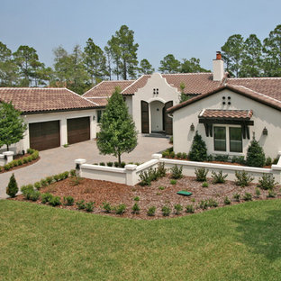 Inspiration for a mediterranean stucco exterior home remodel in Jacksonville