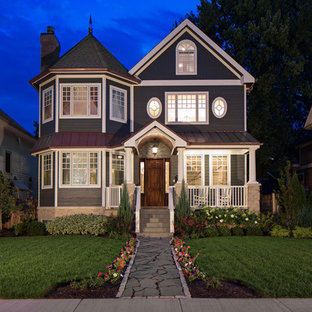 Large traditional gray three-story wood exterior home idea in Chicago