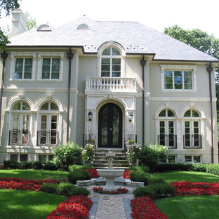 Inspiration for a mid-sized timeless beige two-story stucco exterior home remodel in Chicago