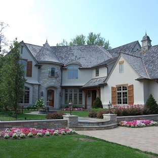 Example of a classic gray two-story exterior home design in Chicago