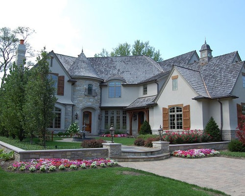example of a classic gray two story exterior home design in chicago - Country Home Exterior