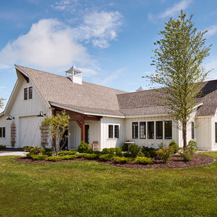 Country white one-story exterior home idea in Milwaukee with a shingle roof