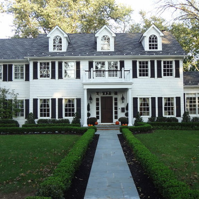 Large elegant white two-story wood gable roof photo in New York