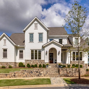 Inspiration for a timeless white two-story brick gable roof remodel in Atlanta