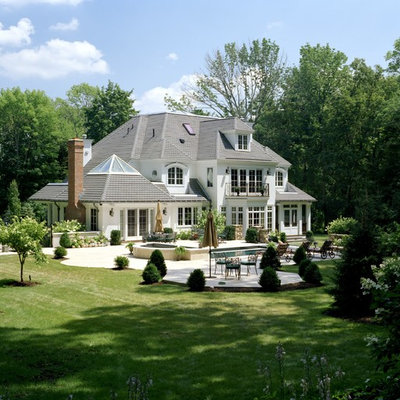 Elegant white two-story exterior home photo in Boston with a hip roof