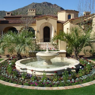 Large southwestern beige three-story stone exterior home idea in Phoenix with a hip roof