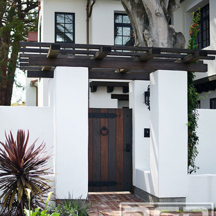 Inspiration for a large and white bohemian two floor render exterior in San Francisco.