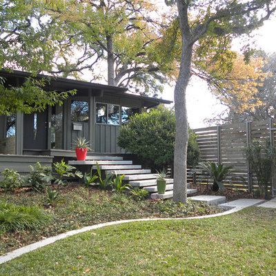 Inspiration for a 1950s one-story exterior home remodel in Dallas