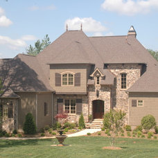Traditional Exterior by EDG PLAN COLLECTION